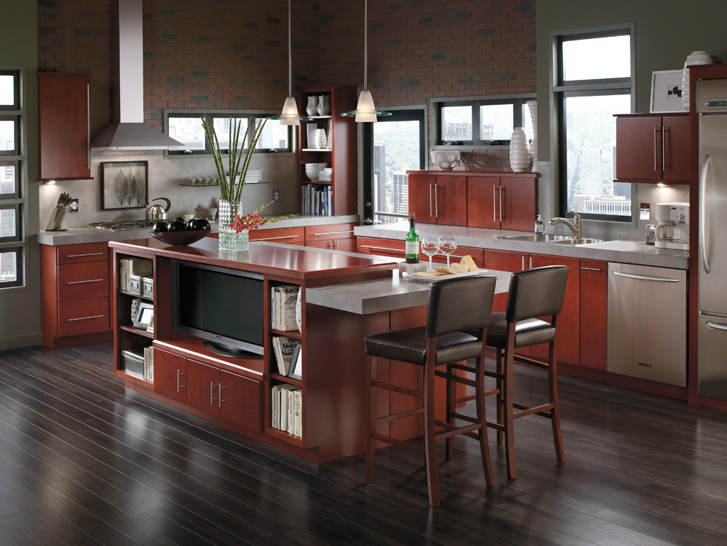 Kitchenland - Open kitchen concept with dark wood floors and cherry wood cabinets