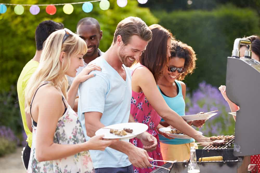 Group of young people enjoying a barbecue